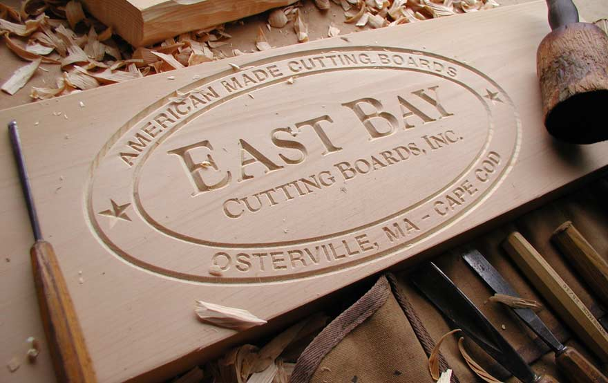 Cutting board with the East Bay logo