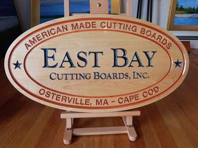 East Bay Cutting Boards logo on wood and in color