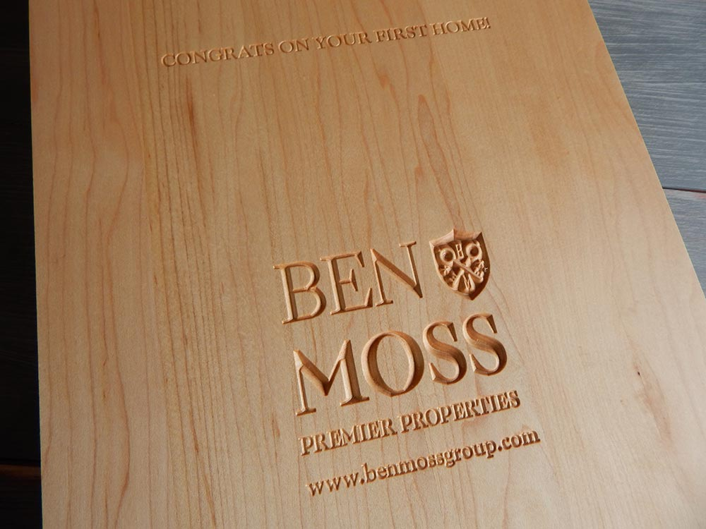 Ben Moss logo carved in a cutting board