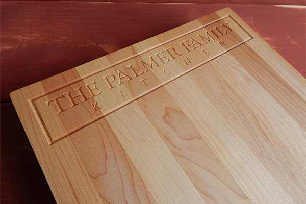 The Palmer Kitchen engraved on a personalized maple cutting board