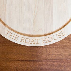 """""""Boat House"""" engraved on a round maple cutting board"""
